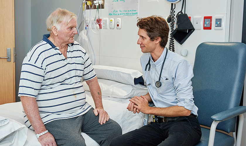 Doctor talking to patient in hospital